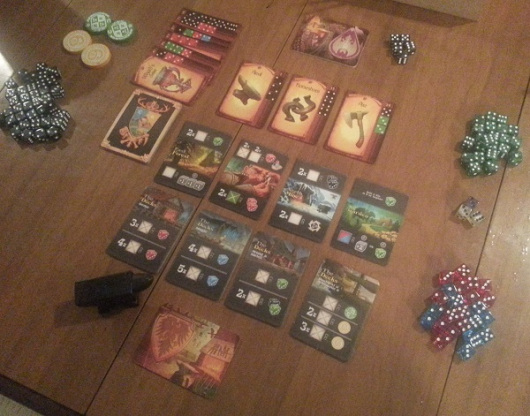 All dice and tokens within reach of all players.